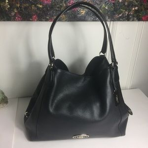 Lightly worn Lovely Coach Edie 31 Black Bag.